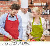 Купить «happy couple and male chef cook cooking in kitchen», фото № 23342062, снято 12 февраля 2015 г. (c) Syda Productions / Фотобанк Лори
