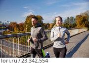happy couple running outdoors. Стоковое фото, фотограф Syda Productions / Фотобанк Лори