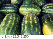 Купить «close up of watermelon at street farmers market», фото № 23343250, снято 27 июля 2015 г. (c) Syda Productions / Фотобанк Лори