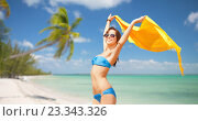 Купить «woman in bikini and sunglasses over tropical beach», фото № 23343326, снято 21 июля 2012 г. (c) Syda Productions / Фотобанк Лори