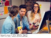 Купить «Graphic designers discussing over computer», фото № 23353262, снято 19 марта 2016 г. (c) Wavebreak Media / Фотобанк Лори