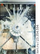 Купить «Milling metalworking process. Industrial CNC metal machining by vertical mill», фото № 23354594, снято 24 мая 2016 г. (c) Дмитрий Калиновский / Фотобанк Лори