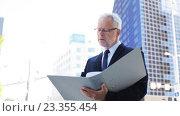 Купить «senior businessman with ring binder folder in city», видеоролик № 23355454, снято 23 июля 2016 г. (c) Syda Productions / Фотобанк Лори