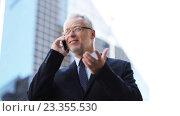Купить «senior businessman calling on smartphone in city», видеоролик № 23355530, снято 23 июля 2016 г. (c) Syda Productions / Фотобанк Лори