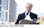 Купить «senior businessman with ring binder folder in city», видеоролик № 23355554, снято 23 июля 2016 г. (c) Syda Productions / Фотобанк Лори
