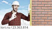 Купить «Builder man with level . Mixed media», фото № 23363814, снято 21 июня 2013 г. (c) Sergey Nivens / Фотобанк Лори