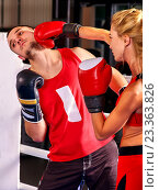 Купить «Female boxer throwing right cross at mitts», фото № 23363826, снято 30 сентября 2015 г. (c) Gennadiy Poznyakov / Фотобанк Лори