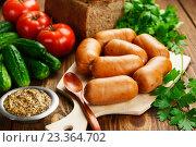 Купить «Сардельки и горчица на столе», фото № 23364702, снято 3 августа 2016 г. (c) Надежда Мишкова / Фотобанк Лори