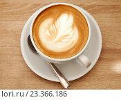 Купить «Чашка капучино, вид сверху», фото № 23366186, снято 6 августа 2016 г. (c) Юлия Кузнецова / Фотобанк Лори