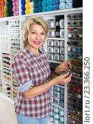 Купить «mature woman in sewing store», фото № 23366250, снято 21 апреля 2019 г. (c) Яков Филимонов / Фотобанк Лори