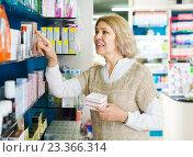 Купить «Female near counter in pharmacy», фото № 23366314, снято 22 октября 2018 г. (c) Яков Филимонов / Фотобанк Лори