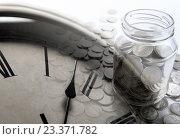 Купить «Банка с монетами и циферблат», фото № 23371782, снято 4 августа 2016 г. (c) Александр Калугин / Фотобанк Лори