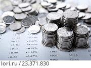 Купить «Стопки монет на финансовых документах», фото № 23371830, снято 3 августа 2016 г. (c) Александр Калугин / Фотобанк Лори
