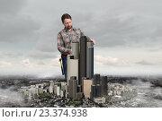 Купить «Adult engineer man . Mixed media», фото № 23374938, снято 24 февраля 2011 г. (c) Sergey Nivens / Фотобанк Лори