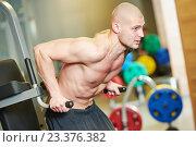 Купить «bodybuiler man at gym have a workout», фото № 23376382, снято 9 марта 2015 г. (c) Дмитрий Калиновский / Фотобанк Лори