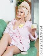 Купить «blonde with face pack relaxing on sofa indoors», фото № 23378794, снято 26 мая 2020 г. (c) Яков Филимонов / Фотобанк Лори