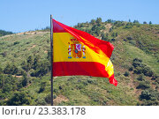 Flag of Spain with mountains at the distance. Стоковое фото, фотограф Яков Филимонов / Фотобанк Лори
