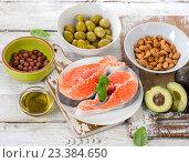 Купить «Food sources of unsaturated fats and Omega 3.», фото № 23384650, снято 25 июня 2016 г. (c) Tatjana Baibakova / Фотобанк Лори