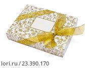 Купить «Коробка в подарочной упаковке на белом фоне», фото № 23390170, снято 3 января 2016 г. (c) Евгений Дробжев / Фотобанк Лори