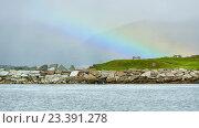 Купить «Северный пейзаж с радугой в туманной дымке. Тромсё, Норвегия», фото № 23391278, снято 15 июля 2016 г. (c) Валерия Попова / Фотобанк Лори
