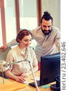 Купить «happy creative team with computer in office», фото № 23402646, снято 29 марта 2015 г. (c) Syda Productions / Фотобанк Лори
