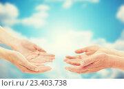 Купить «close up of senior and young woman hands», фото № 23403738, снято 10 июля 2015 г. (c) Syda Productions / Фотобанк Лори