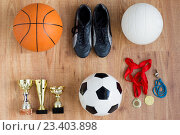 Купить «sports balls, boots, cups, whistle and medals», фото № 23403898, снято 17 июня 2016 г. (c) Syda Productions / Фотобанк Лори
