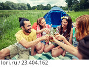 Купить «happy friends with tent and drinks at campsite», фото № 23404162, снято 25 июля 2015 г. (c) Syda Productions / Фотобанк Лори