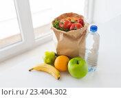 Купить «basket of vegetable food and water at kitchen», фото № 23404302, снято 3 июня 2016 г. (c) Syda Productions / Фотобанк Лори