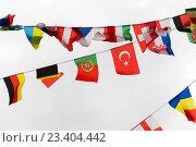 Купить «close up of international flags garland decoration», фото № 23404442, снято 21 июня 2016 г. (c) Syda Productions / Фотобанк Лори