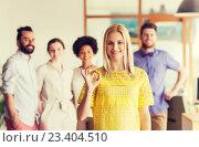 Купить «happy woman showing ok over creative office team», фото № 23404510, снято 29 марта 2015 г. (c) Syda Productions / Фотобанк Лори