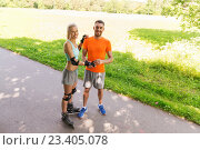 Купить «happy couple with roller skates riding outdoors», фото № 23405078, снято 5 июля 2015 г. (c) Syda Productions / Фотобанк Лори