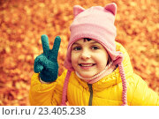 Купить «happy little girl in autumn park», фото № 23405238, снято 10 октября 2015 г. (c) Syda Productions / Фотобанк Лори