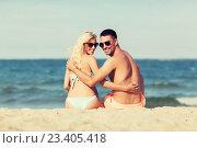 Купить «happy couple in swimwear sitting on summer beach», фото № 23405418, снято 11 августа 2015 г. (c) Syda Productions / Фотобанк Лори
