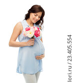 Купить «happy pregnant woman with flowers touching belly», фото № 23405554, снято 20 мая 2016 г. (c) Syda Productions / Фотобанк Лори