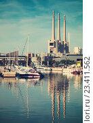 Купить «Port de Badalona with chimneys abandoned power plant in background», фото № 23411562, снято 2 июня 2014 г. (c) Яков Филимонов / Фотобанк Лори