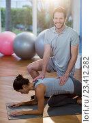 Купить «Physiotherapist assisting a female patient while exercising», фото № 23412282, снято 1 июня 2016 г. (c) Wavebreak Media / Фотобанк Лори