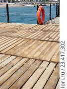Купить «REd Lifebuoy on wooden pier», фото № 23417302, снято 3 августа 2016 г. (c) Кравецкий Геннадий / Фотобанк Лори
