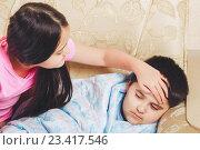 Купить «Девочка проверяет есть ли у брата температура», фото № 23417546, снято 19 августа 2016 г. (c) Emelinna / Фотобанк Лори