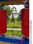 Купить «Сибирь. Бурятия. Буддийское святое место на въезде в Тункинскую долину. Вид на ступу Даши Гоман через красные молитвенные барабаны», фото № 23418502, снято 11 июня 2016 г. (c) Виктория Катьянова / Фотобанк Лори