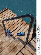 Купить «Step-ins on the sea pier stairs», фото № 23427354, снято 3 августа 2016 г. (c) Кравецкий Геннадий / Фотобанк Лори