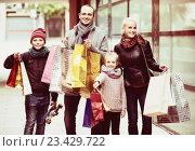Купить «Parents with children shopping in city», фото № 23429722, снято 24 сентября 2018 г. (c) Яков Филимонов / Фотобанк Лори