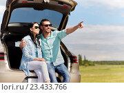 Купить «happy couple hugging at open hatchback car trunk», фото № 23433766, снято 12 июня 2016 г. (c) Syda Productions / Фотобанк Лори
