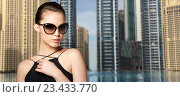 Купить «beautiful young woman in elegant black sunglasses», фото № 23433770, снято 9 апреля 2016 г. (c) Syda Productions / Фотобанк Лори