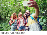 Купить «friends with backpack taking selfie by smartphone», фото № 23433854, снято 25 июля 2015 г. (c) Syda Productions / Фотобанк Лори