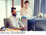 Купить «business team with computer and files in office», фото № 23434054, снято 29 марта 2015 г. (c) Syda Productions / Фотобанк Лори