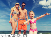 Купить «close up of happy family with child on beach», фото № 23434178, снято 11 августа 2015 г. (c) Syda Productions / Фотобанк Лори
