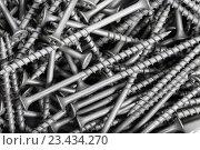 Купить «Background pattern of screws», фото № 23434270, снято 12 августа 2016 г. (c) Сергей Лаврентьев / Фотобанк Лори