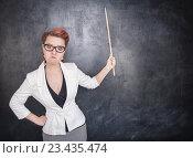 Сердитый учитель указывает на доску. Стоковое фото, фотограф Darkbird77 / Фотобанк Лори