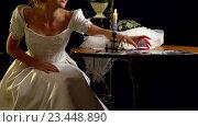 Купить «Woman in a wedding dress puts on wedding garter.», видеоролик № 23448890, снято 22 августа 2016 г. (c) Gennadiy Poznyakov / Фотобанк Лори